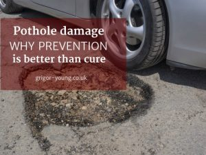 Car avoiding pothole in the road