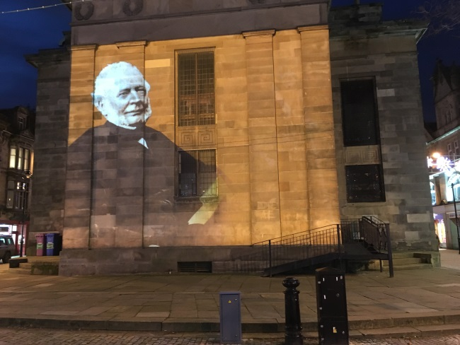 Robert Young projected on the wall of St Giles' Church, Elgin, as part of the Christmas lights 2017