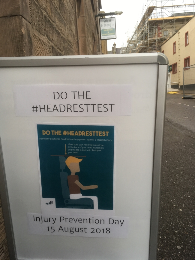 Sign outside Grigor & Young LLP, Elgin, promoting Injury Prevention Day 2018