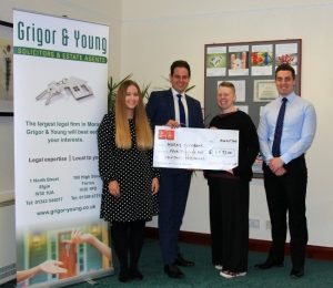 Grigor & Young LLP hand over a cheque to Moray Foodbank