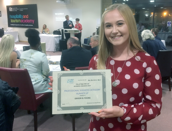 Lauryn of Grigor & Young with G&Y's runners-up certificate in the Professional Services category at the Elgin BID Business Awards 2019